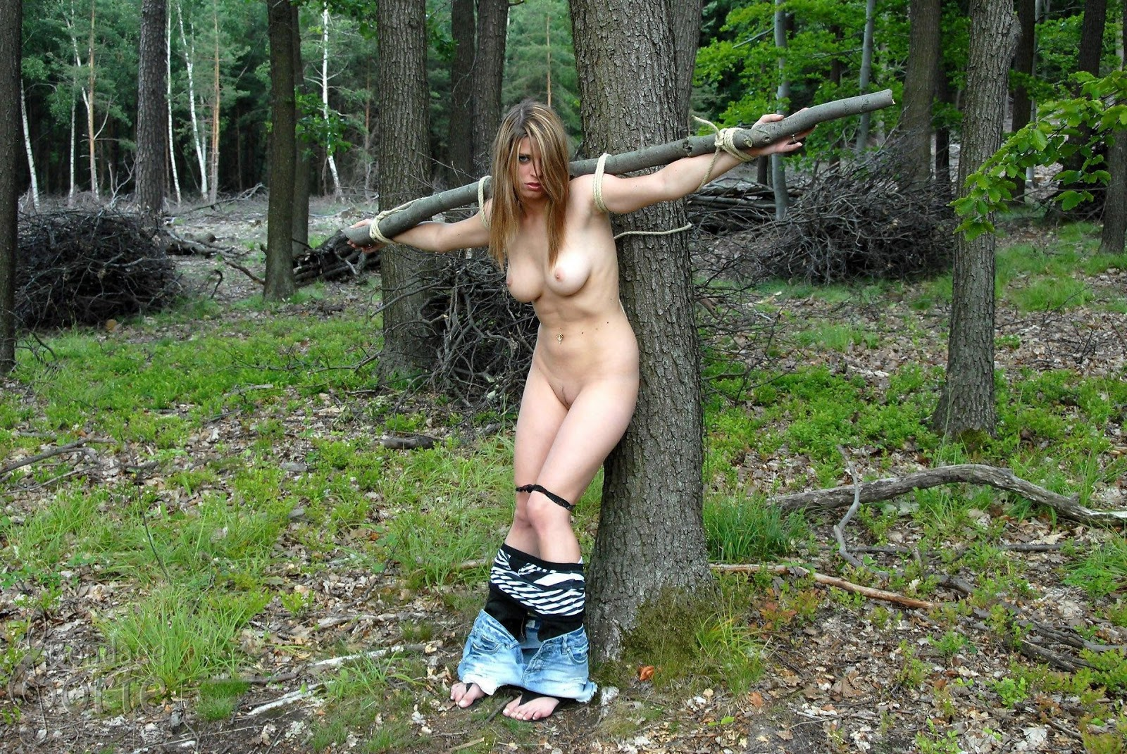 nude sexy girl outdoor bondage
