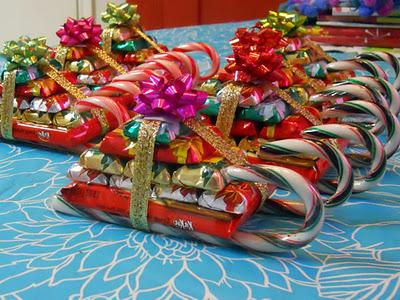 this isnt a unique candy craft idea there are many variations a helpful tip may be to save some used wrapping paper after gifts are opened this year and - Christmas Candy Sleigh