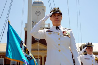 Rear Adm. Sandra Stosz salutes during the change of command ceremony at the United States Coast Guard Academy June 3, 2011.