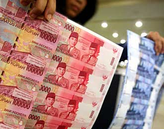 bahaya ancaman uang palsu