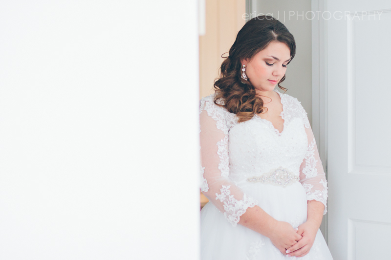 bride looking down wearing lacy dress