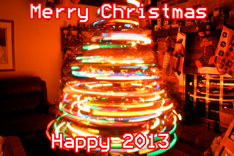 Image of a spinning Christmas Tree, with the words, Merry Christmas, Happy 2013.