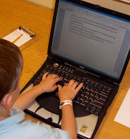 typing on laptop - Brick by Brick
