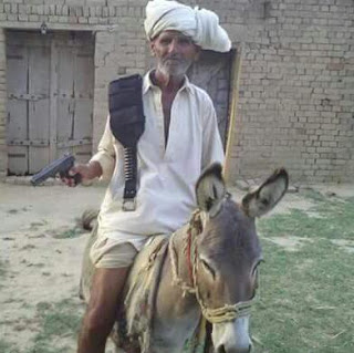 Funny old man with donkey and gun