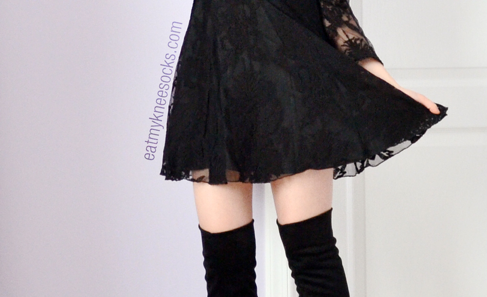 The scalloped lace hemline on the SheInside dupe of the Free People Reign Over Me lace dress in black.