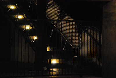 photo of lighted stairway from ground level parking in 92103