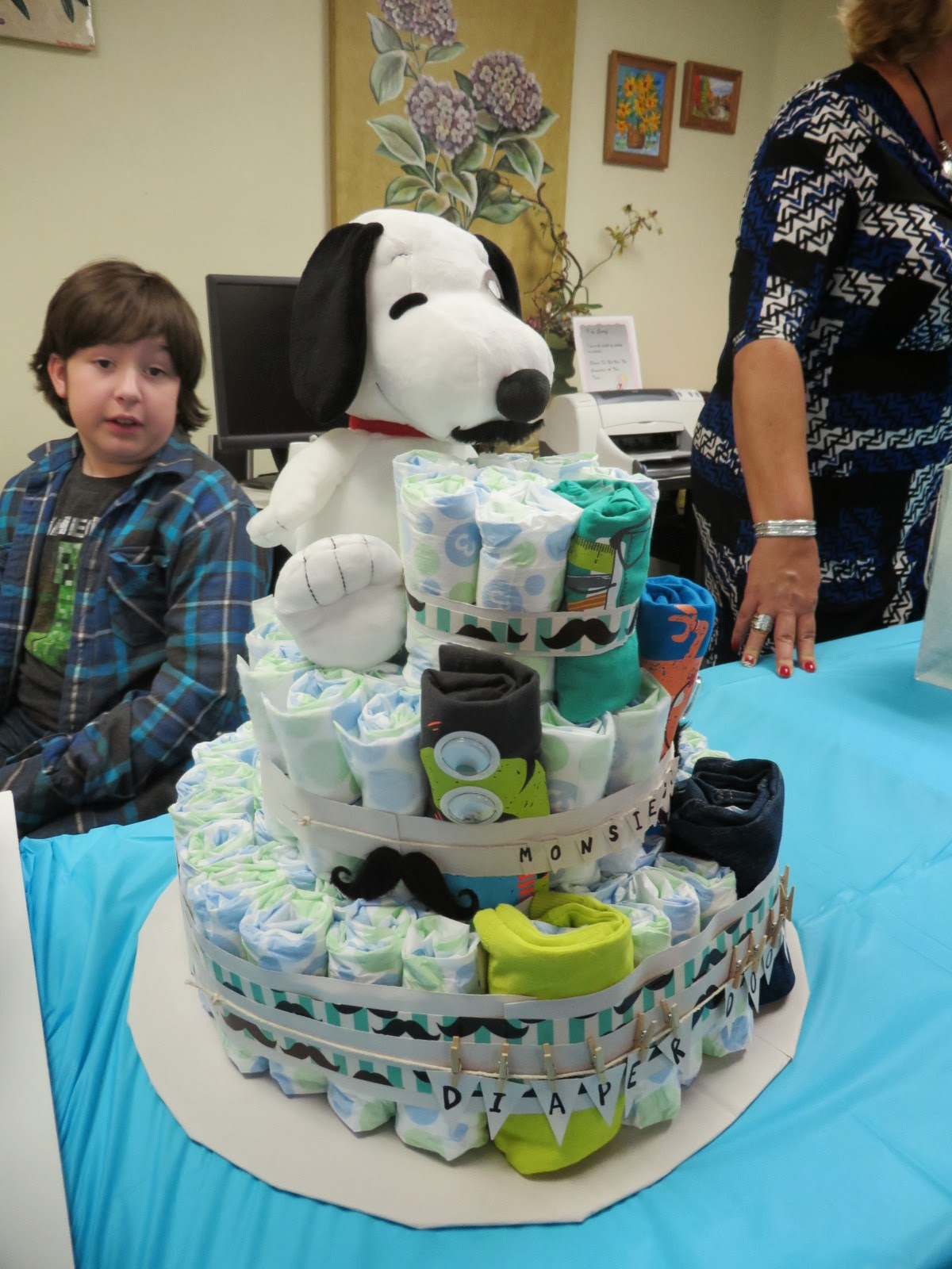 such a cute diaper blanket outfit cake with snoopy on top