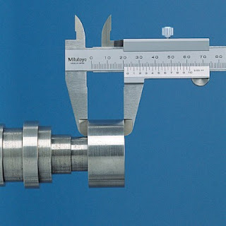 Vernier caliper used for measuring outside diameter.