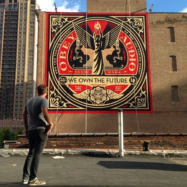Shepard Fairey aka Obey Giant is currently busy working on the streets of Chicago where he just finished working on this first new piece for the Art Alliance exhibition.