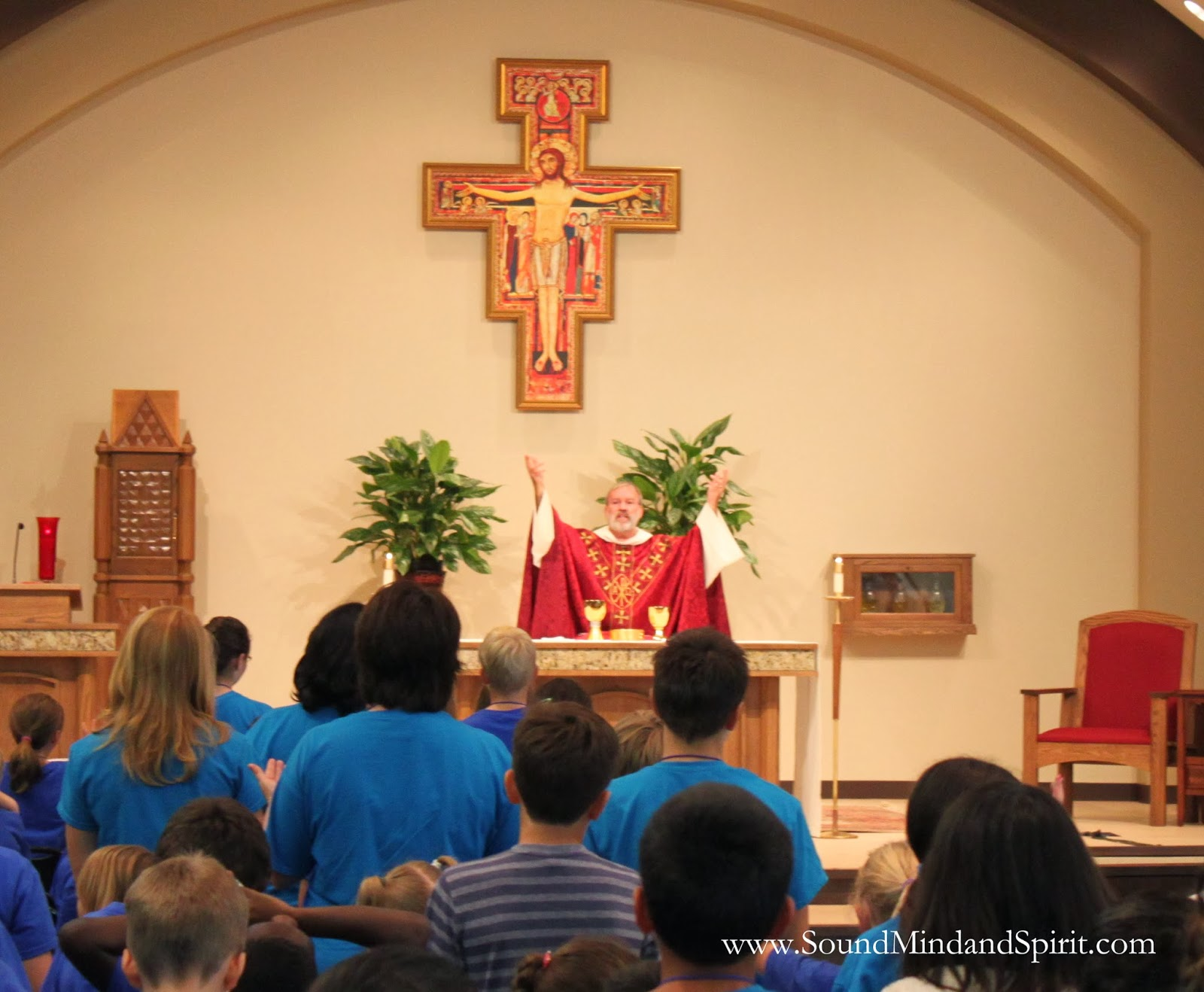 Fr. John Rooney celebrating Mass at St. Angela Merici during VBS