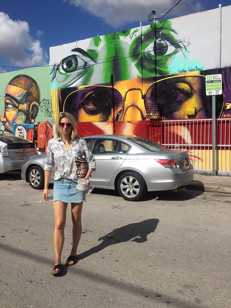 Fashion Over Reason in Wynwood, Miami, Raen Arkin sunglasses, Ann Taylor blouse, Gap denim cutoff skirt, H&M slides, Zara clutch, street art mural, Wynwood Miami