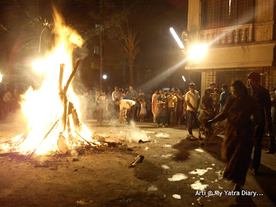 Offering water to the to the Holika Dahan bonfire on Choti Holi