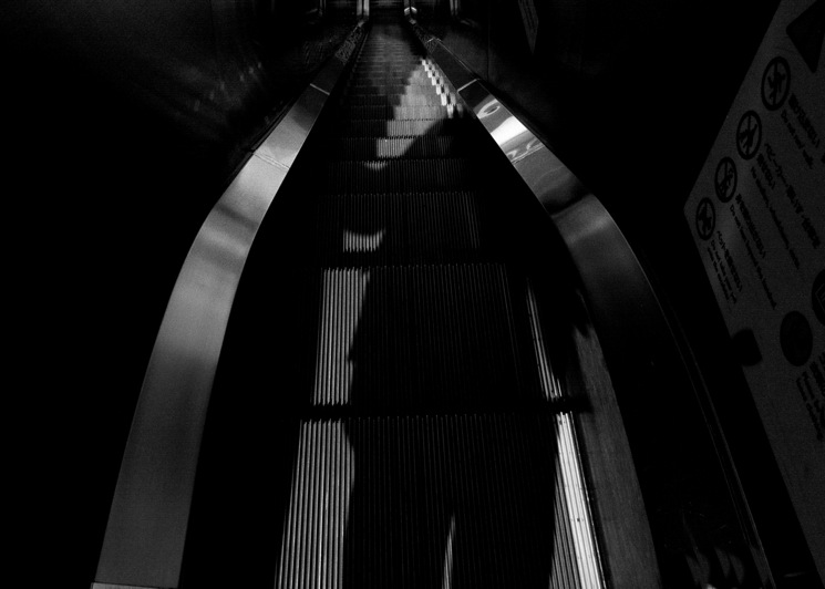 The shadow in the escalator