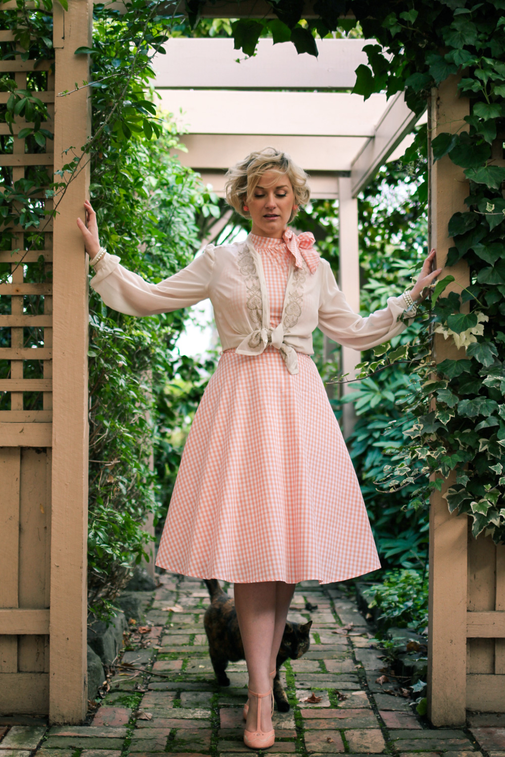 @findingfemme wears pink gingham Voodoo Vixen dress with Bettie Page t-bar heel and sheer blouse.