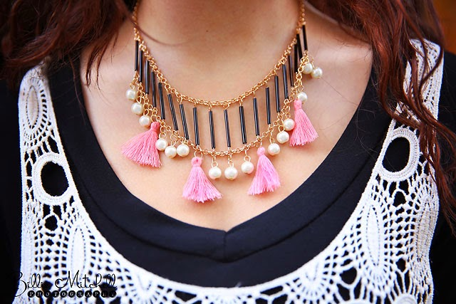 gold necklace with pearls and coral tassel dangles