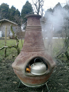 Cooking on a chimnea.