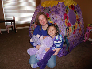 My daughter, Lily, with her favorite purple elephants