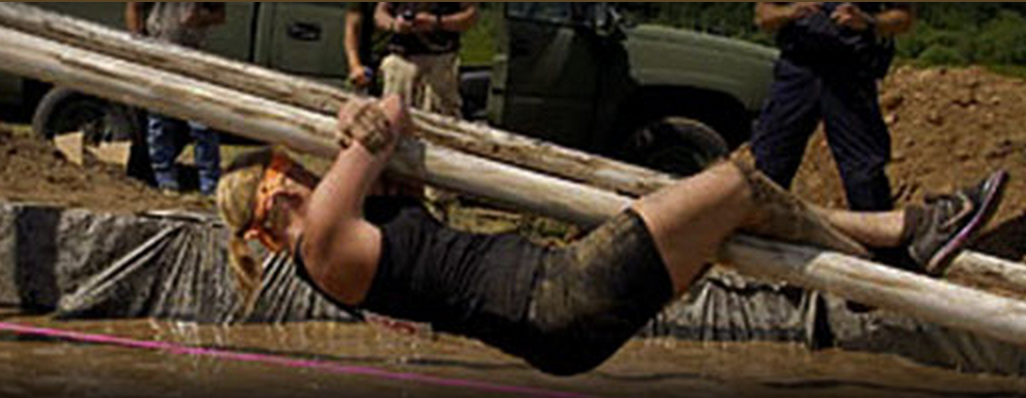 Bethany Ontario Mud Run Supporting Canadian Cancer Society Features Obstacles like pole sliding across a mud pit