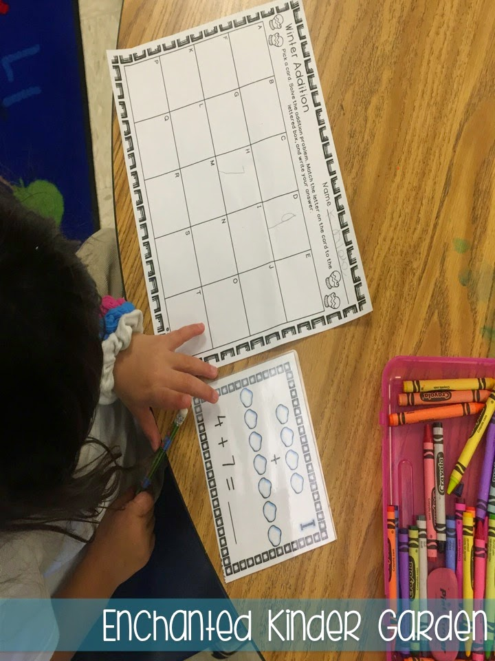 This is a photograph of a student completing a kindergarten math task card activity.