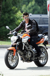 Taylor Lautner riding a bike