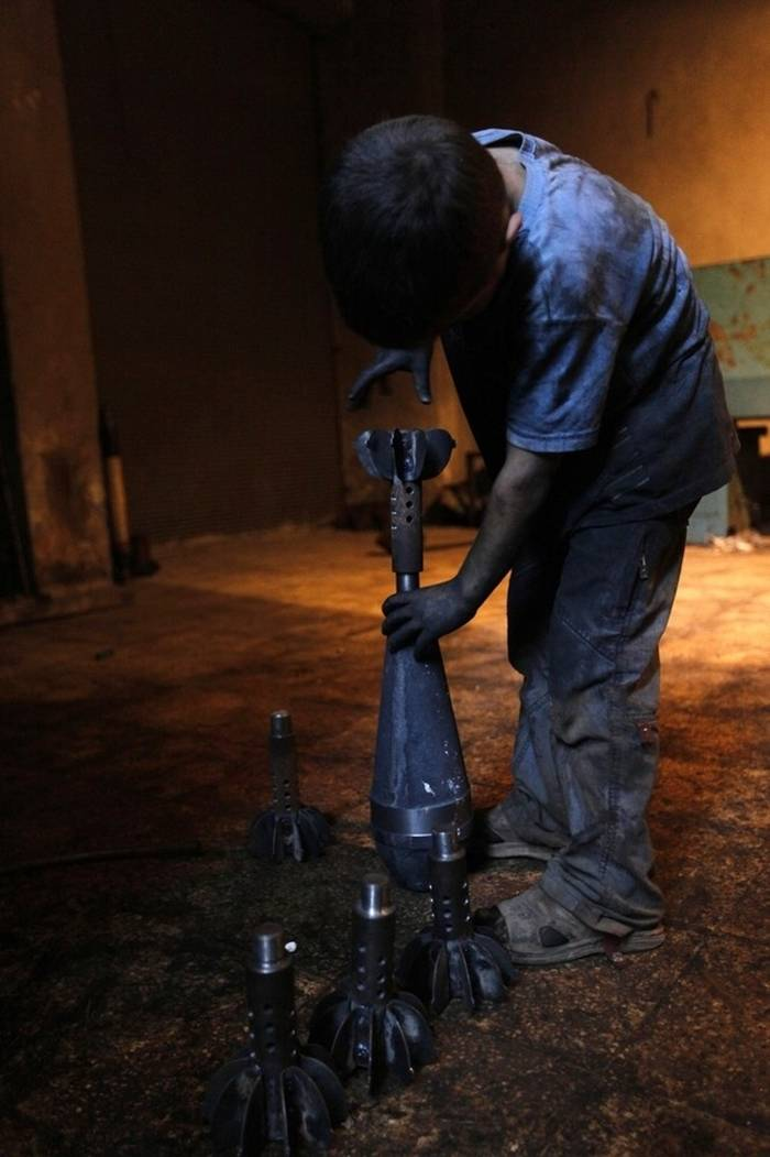 Issa makes mortars to be used by the Free Syrian Army.