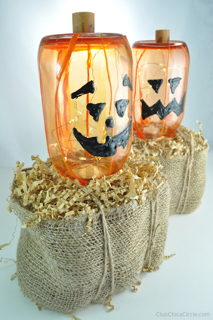 http://club.chicacircle.com/glass-pumpkin-jack-o-lanterns-on-homemade-hay-bales/