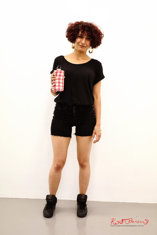 Large hoop earings, black tee and black cut-off denim shorts with black hi-top basketball shoes.