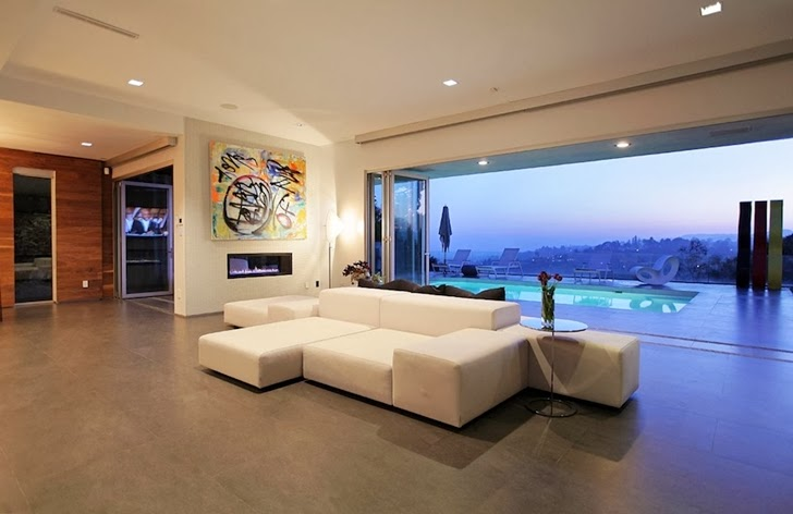Living room furniture in Modern Beverly Hills House with open interiors