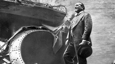 Sir Henry Wood surveys the bomb damage after an air raid destroys the Queen's Hall, 1941