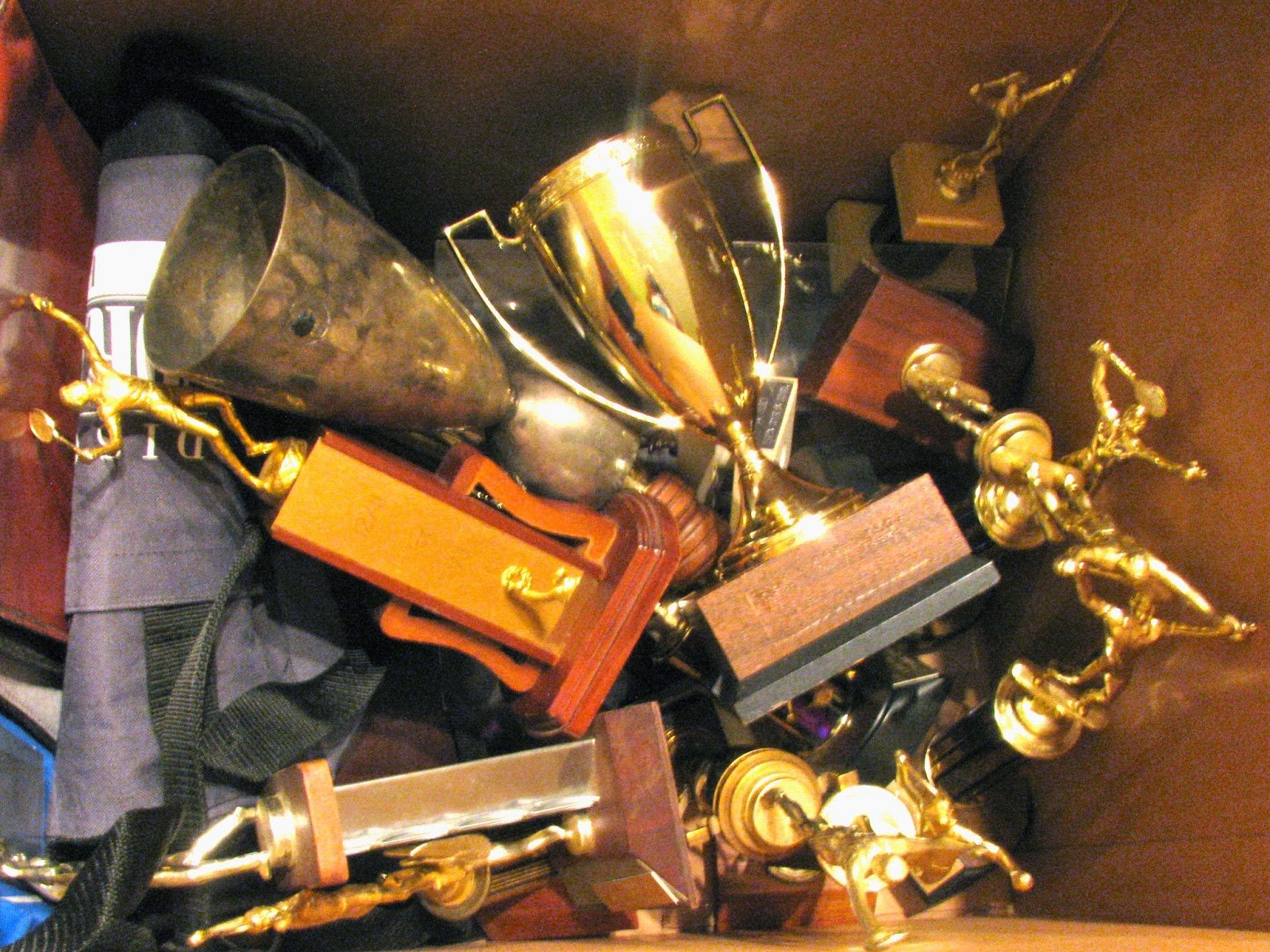 What are some ways to donate used trophies?