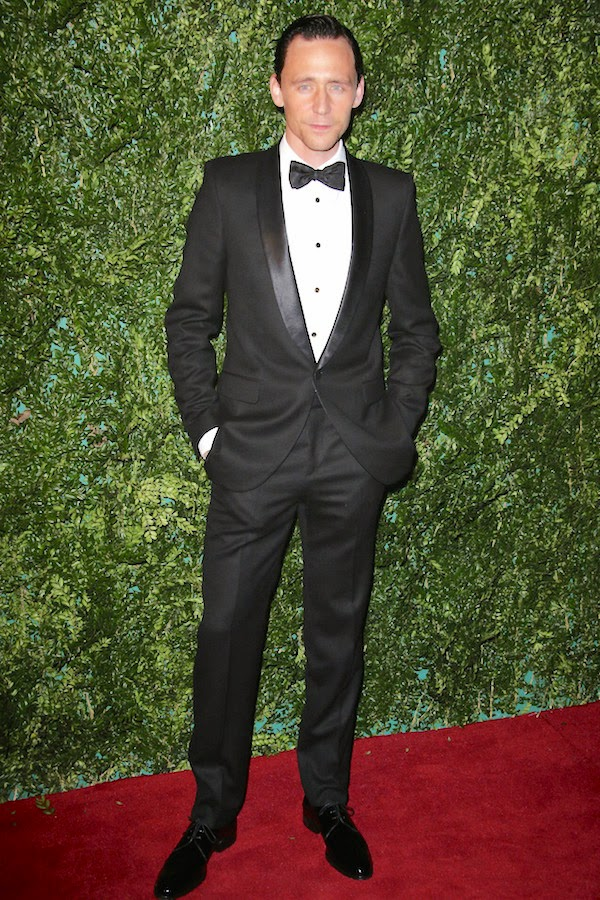 Tom Hiddleston wears Alexander McQueen tuxedo and Mr Hare shoes to 60th Evening Standard Theatre Awards at the London Palladium November 30th 2014