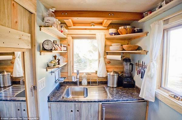 While the walls are lined with shelves to help with kitchen storage.