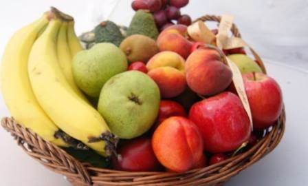 Fruit Basket filled with Bananas, Apricots, Cherries, Apples