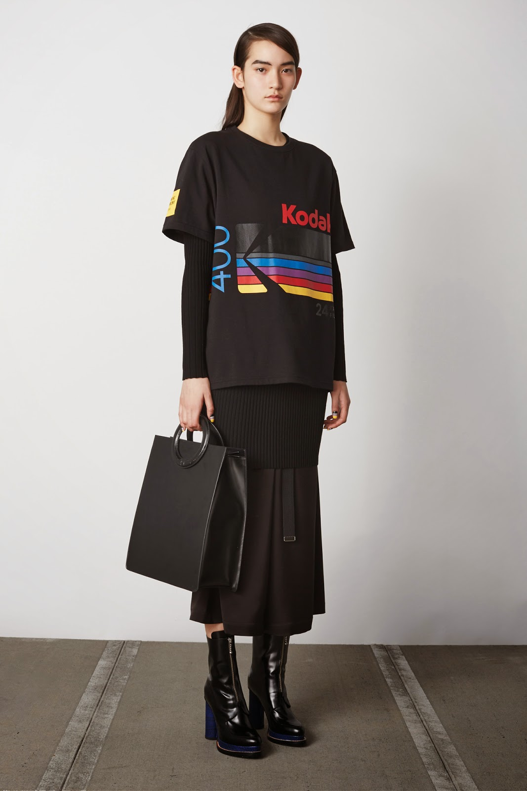 Opening Ceremony Fall Winter 2015 black short sleeved Kodak print sweater, black skirt, black tote