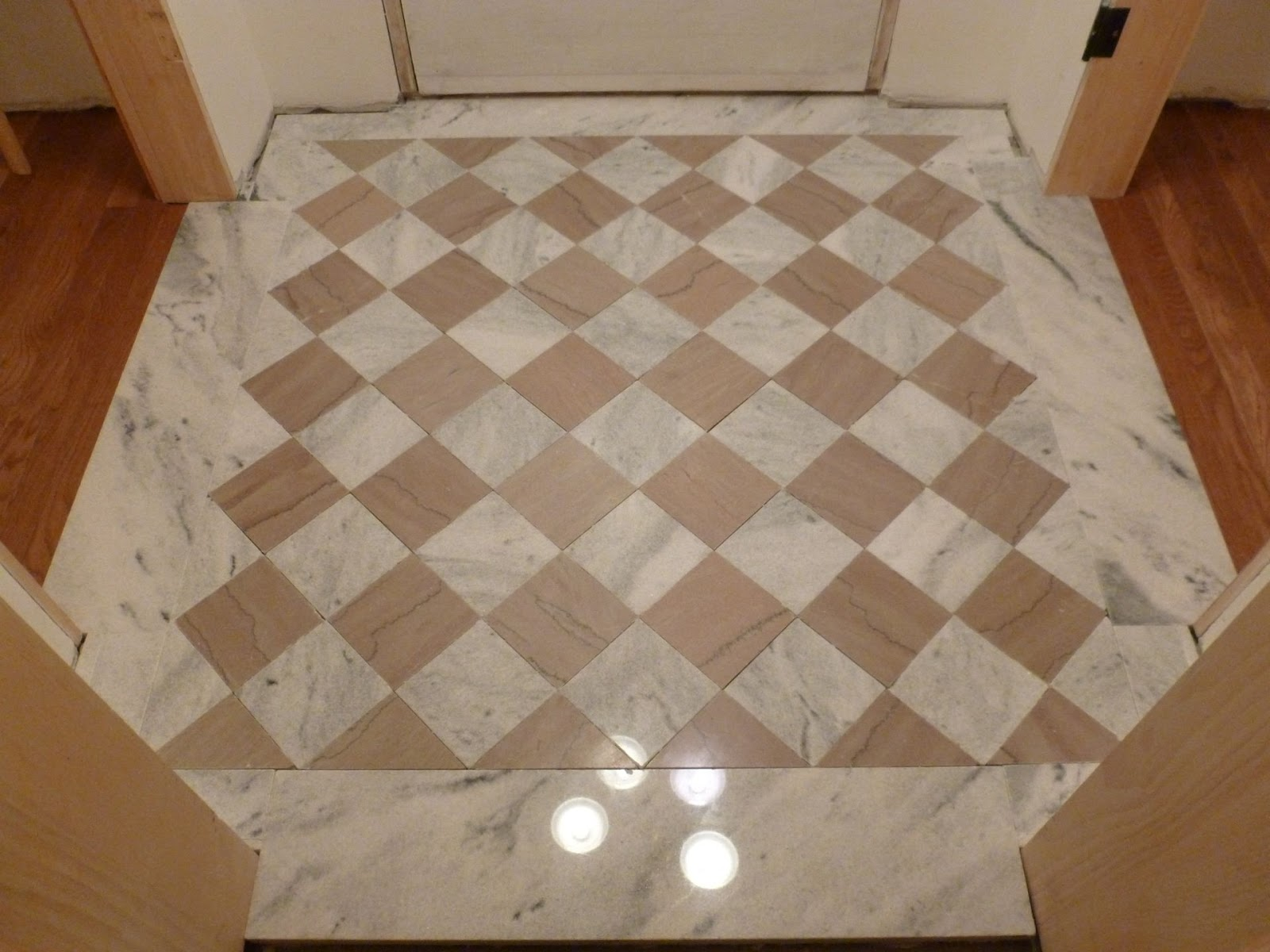 Handyman in the iowa illinois quad cities installing a very marble tile installed in the floor but without the grout the customer didnt intend for grout to be used however mainly because the white tiles had a dailygadgetfo Gallery