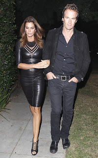 Cindy Crawford wearing a leather dress