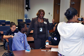 Terri McGee, Assistant Deputy Director for Harris County Juvenile Probation, talks to students following a presentation on internships.