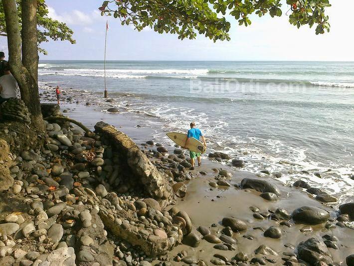Medewi beach with big stones on the beach.