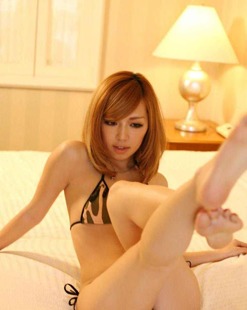 Risa Kouda sexy on the bed