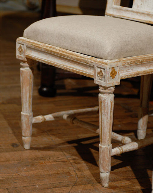 A Close Up Image Of The Rosettes And Fluted Legs Of Our Gustavian Chairs.