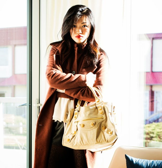 Vancouver Fashion blogger Jasmine Zhu wearing ruffle shirt, leather shorts and textured tights, obakki cashmere full length coat