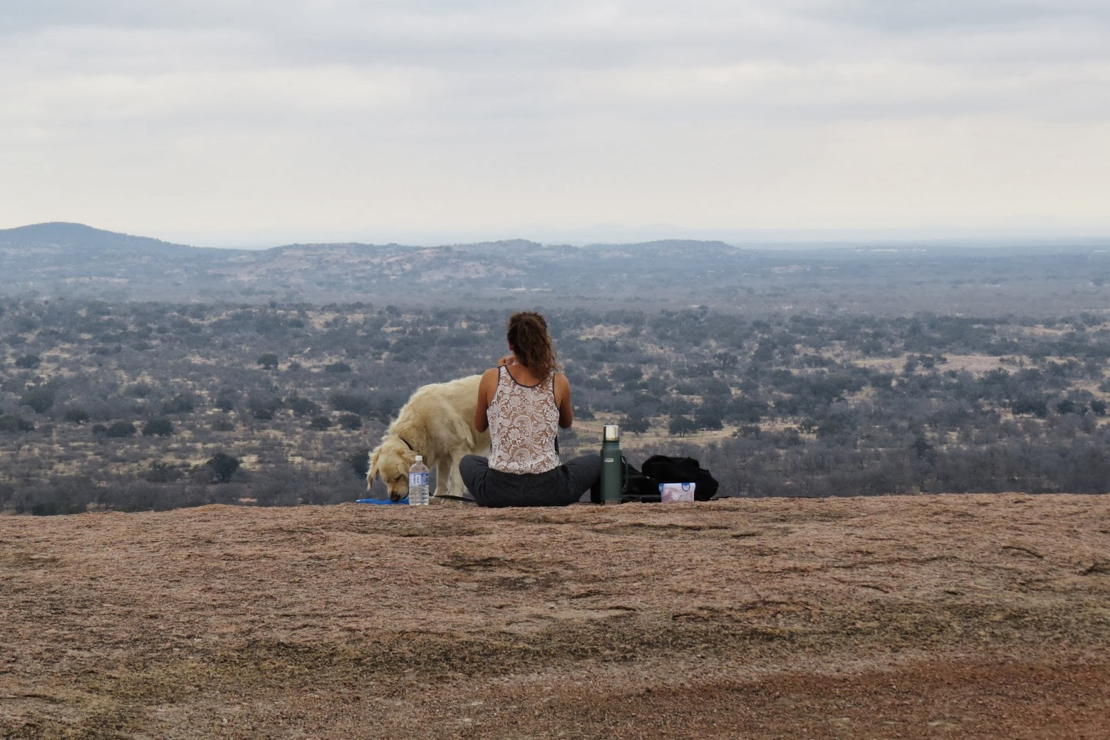 Naomi and Boris the golden retriever at Enchanted Rock State Park, Texas