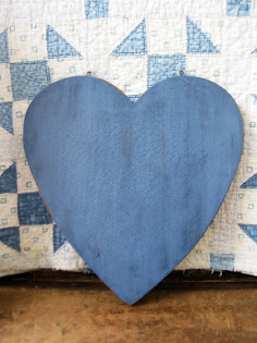 a blue heart bread board