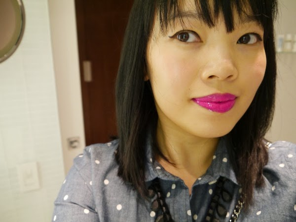 Fuchsia lips and winged eyeliner