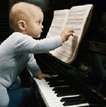 Small baby shown playing a piano after the piano has been cleaned.