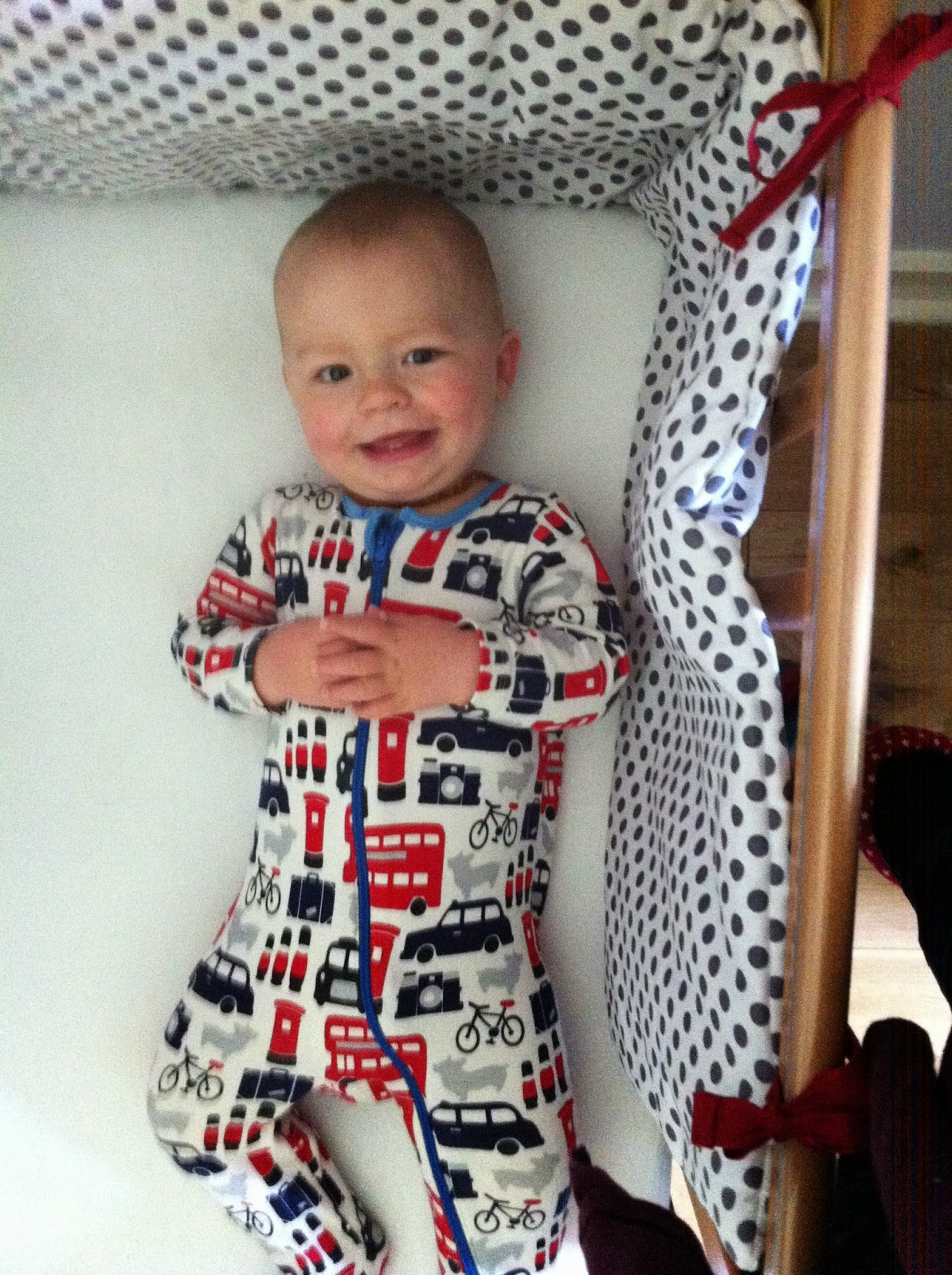 Finley in cot with handmade cot bumper