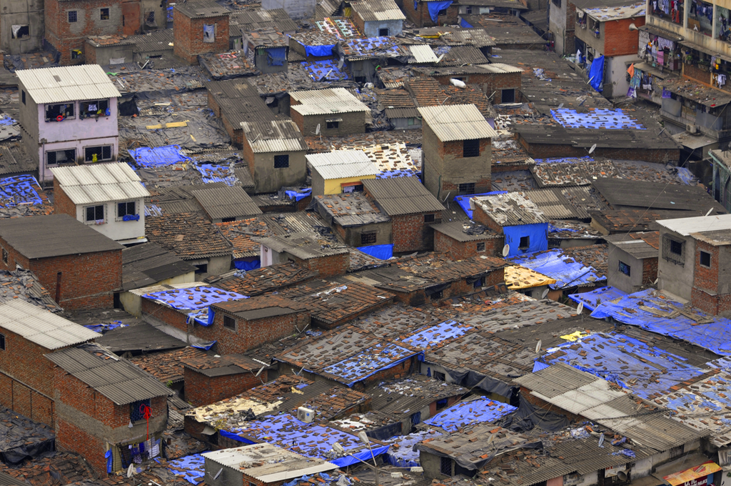 Image of Dharavi from above which is a vivid scenery of blue and brown colors.