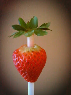 Core a strawberry with a straw!