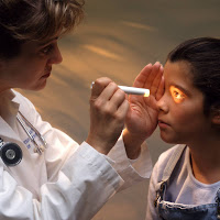 Vancouver's pediatric optometirst - doctor examining a child's eyes