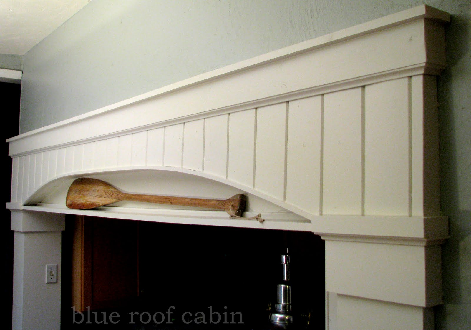 blue roof cabin: Archway to a Tiny Kitchen